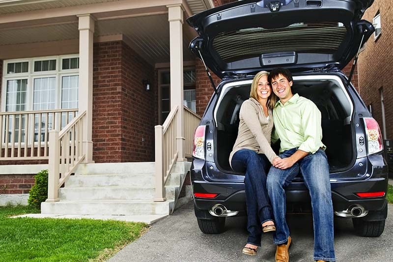 Couple in a new car